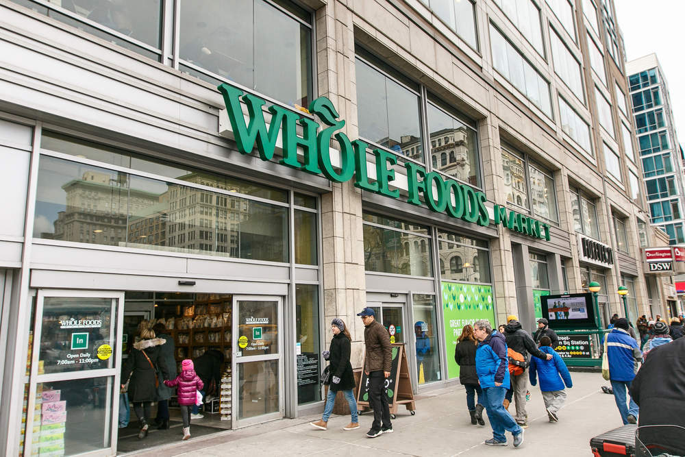 Why does Amazon want to acquire Whole Foods?