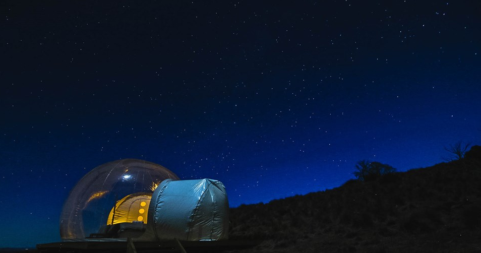 sleep under the stars in these luxury bubble dome glampsites