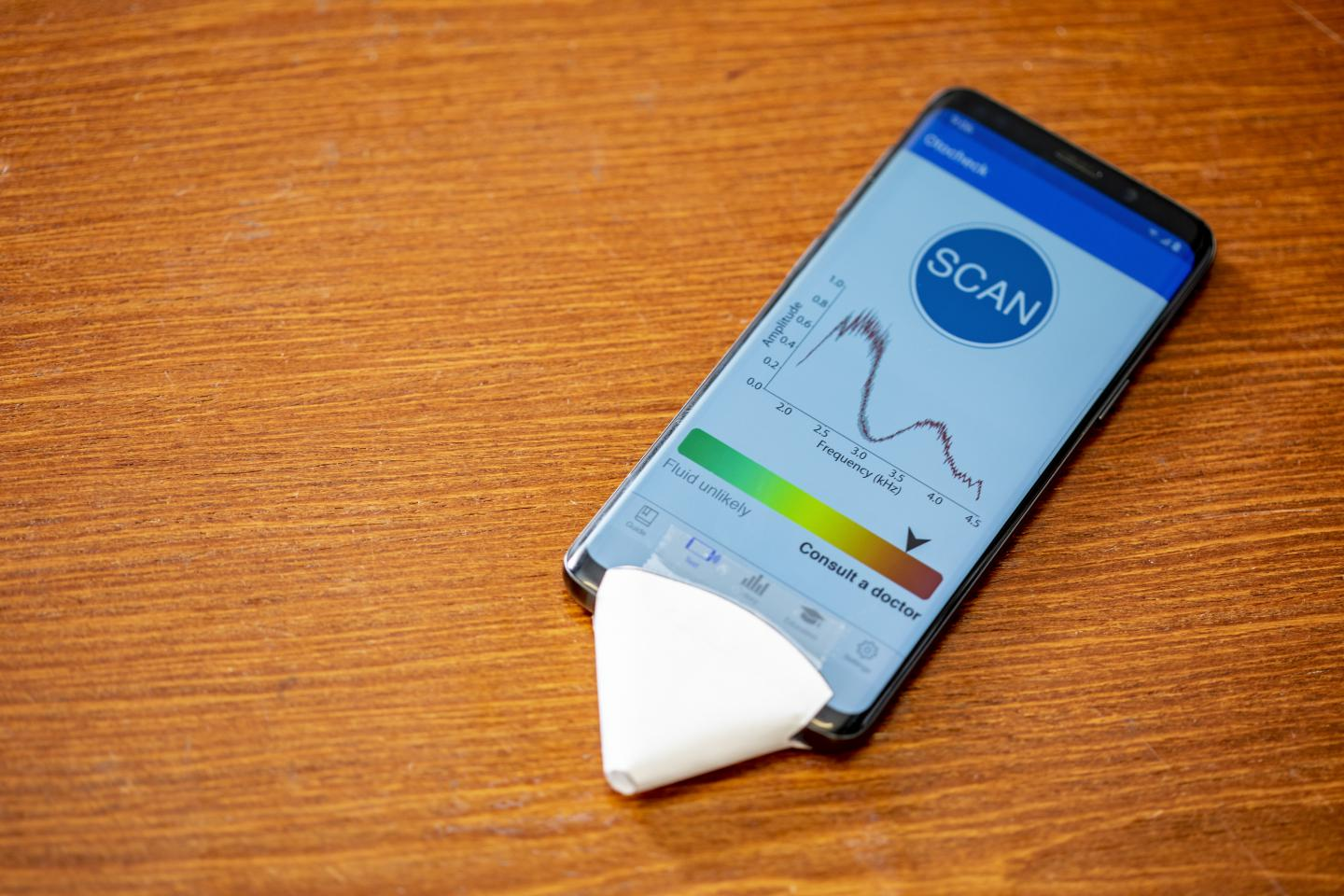 This smartphone app hears ear infections using a paper cone