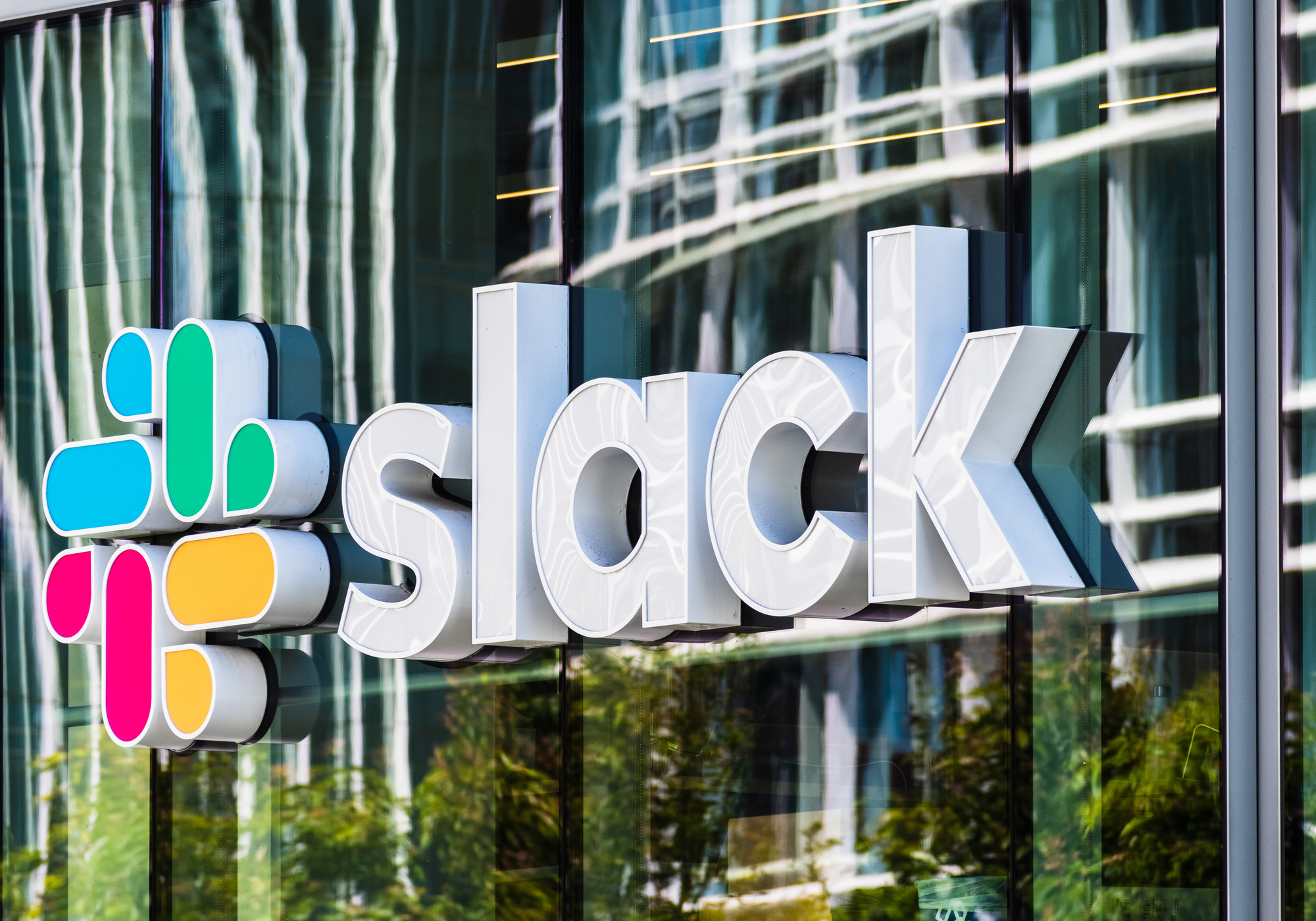 Slack narrows losses with steady Q2 growth